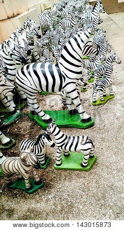 Zebra Stucco Votive Offering To Guardian Spirit Away.