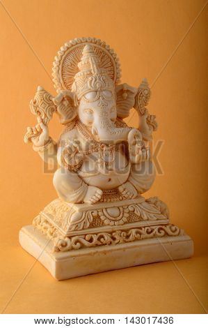 Hindu God Ganesha. Ganesha Idol on yellow Background.