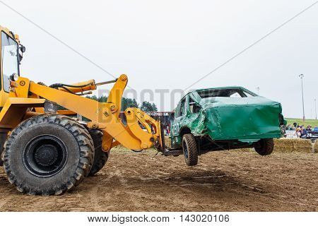 GRODNO BELARUS - AUG 13: The forklift evacuates The figth Car from arena fights for survival on August 13 2016 in Grodno Belarus