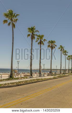 Perspective view of boardwalk and empty street in Piriapolis Uruguay