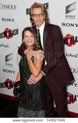 NEW YORK-AUG 3: Musician Rick Springfield (R) and wife Barbara Porter attend the 'Ricki And The Flash' New York premiere at AMC Lincoln Square Theater on August 3, 2015 in New York City.