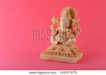Hindu God Ganesha. Ganesha Idol on Pink Background.