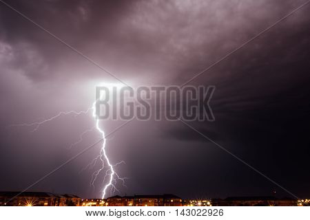 a very beautiful lightning over the city