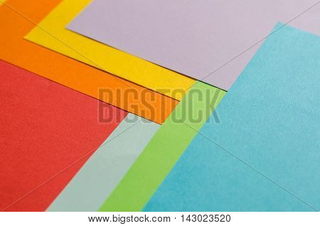 Multicolor sheets of color paper abstract background