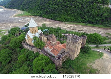 Photos from the air Ananuri fortress on a background of a dried river Aragvi shot quadrocopters DJI
