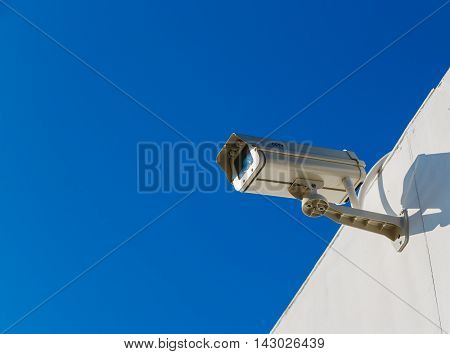 CCTV on building with blue -sky background