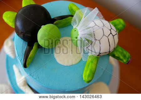 Beach themed custom wedding cake with sea turtles dressed as bride and groom