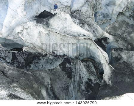 Glacier meander outlined with volcanic ash on Myrdalsjokull glacier near Eyjafallajokull volcano, Iceland