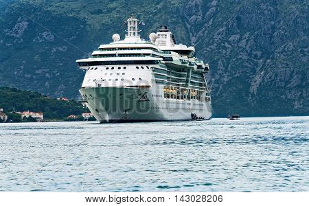 Kotor Montenegro - June 16, 2016: The Brillance of the Seas is anchored in the Bay of Kotor and tender boats are used to transport passengers to shore in Kotor.
