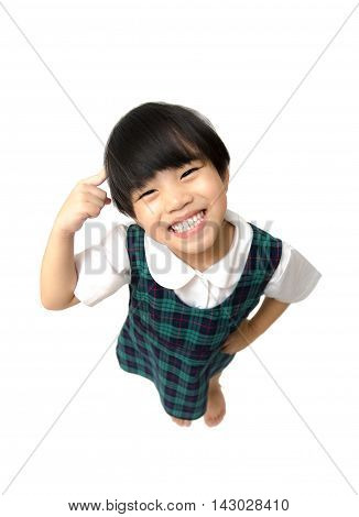 happy schoolgirl childhood and education concept - happy little girl Finger pointed at the headFinger