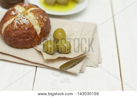 Bread and green olives - organic food healthy background (shallow DOF)