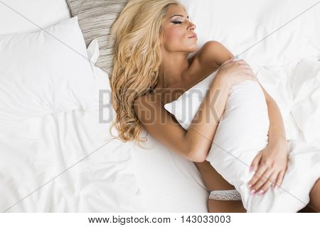 Pretty Young Woman On The Bed