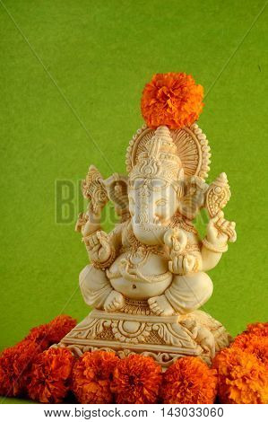 Hindu God Ganesha. Ganesha Idol on Green Background.