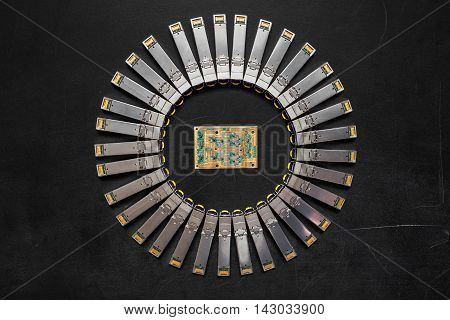 Electrical internet SFP network modules for network switch and electronic gold plated circuit board with microchips and transistors diode on the black background