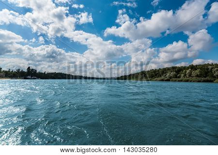 Summer beautiful landscape with river, blu sky and clouds in Russia