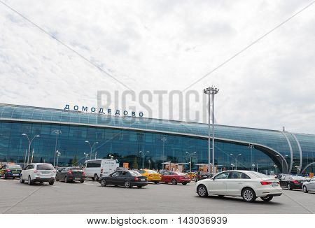 The Moscow region - 31 July 2016: Passenger Domodedovo airport terminal and many cars waiting for passengers 31 July 2016 Moscow region Russia