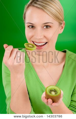 Healthy Lifestyle - Happy Woman Holding Kiwi And Teaspoon