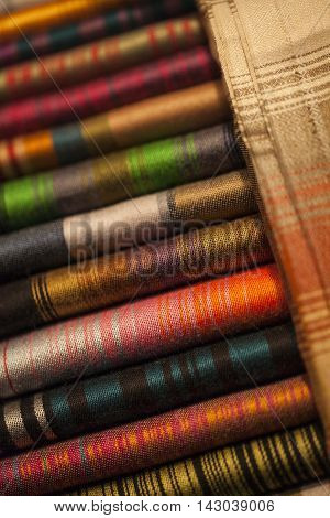 Image of wool and silk scarfs in a asian market.