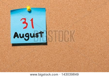 August 31th. Day 31 of month, color sticker calendar on notice board. Summer time. Empty space for text.