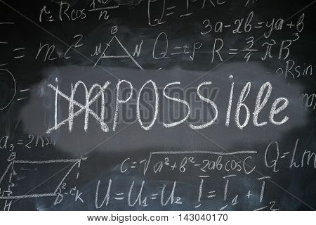 Impossible word turned into possilble by crossing on black board with math formulas