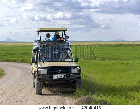 AFRICA, TANZANIA, MAY, 06, 2016 - Visitors on jeep take  pictures of wild animals in Tarangire National Park, Tanzania.