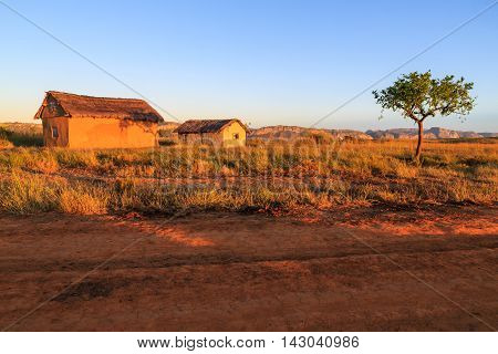 Village In An African Landscape At Sunrise