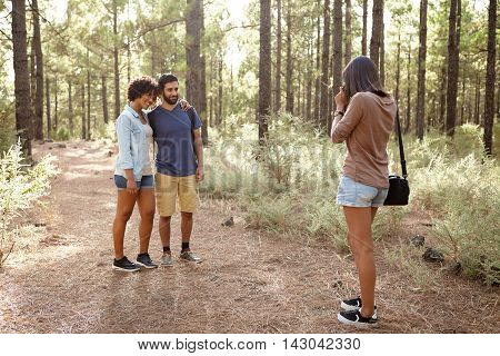 Friends Taking Pictures In A Forest