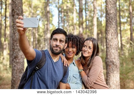 Taking Selfies In A Pine Forest