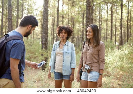 Three Friends Looking At A Cell Phone
