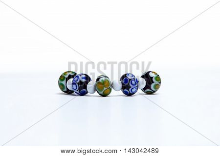 Bracelet with glass beads on white background