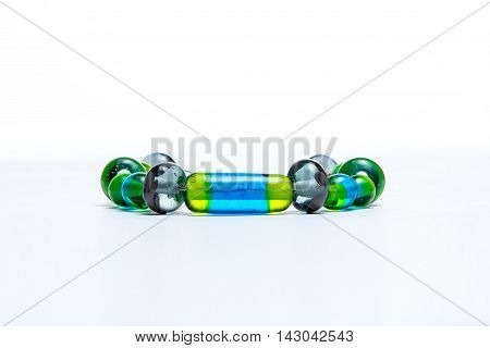 Bracelet with green glass beads on white background