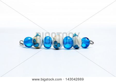 Bracelet with white and blue glass beads on white background