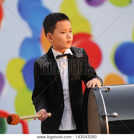 Orel Russia - August 05 2016: Orel city day. Chinese musician boy playing drum closeup