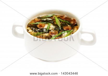 tasty brown Asian soup on white background