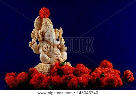Hindu God Ganesha. Ganesha Idol on Blue Background.