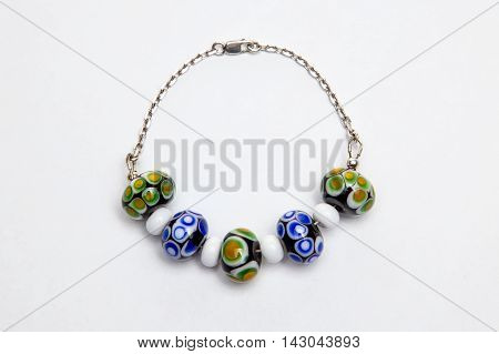 Bracelet with multi-colored glass beads on white background