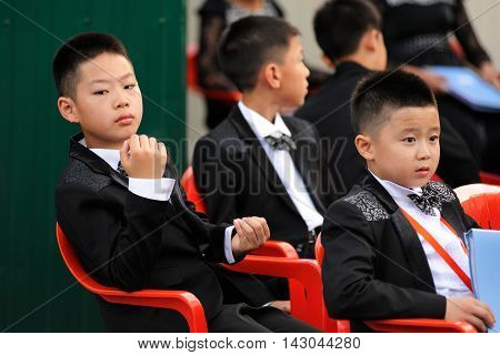 Orel Russia - August 05 2016: Orel city day. Young Chinese musicians in uniforms closeup