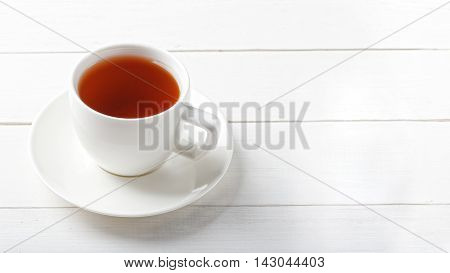 White Cup Of Tea On A White Wooden Table.