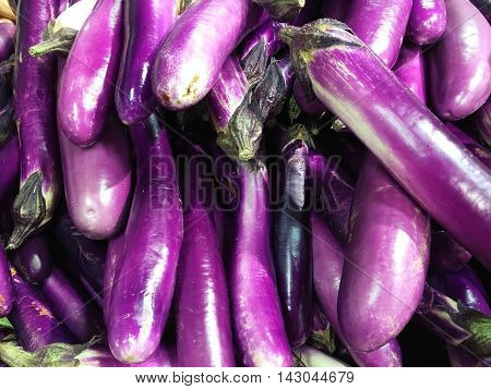 bulk of purple Eggplant close-up in the market