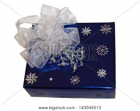 Very luxury wrapping gift with white bow and snowflakes