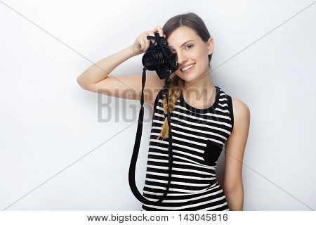 Portrait Of Smiling Happy Young Beautiful Woman In Striped Shirt Posing With Black Photo Camera Agai