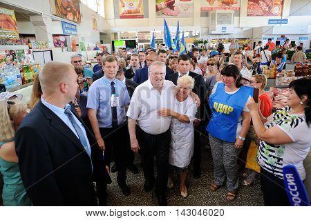 Orel Russia - August 05 2016: Orel city day. Vladimir Zhirinovsky meets people and hugs woman at markrt place