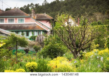 House and garden where painter Claude Monet lived and worked in Giverny village Upper Normandy France