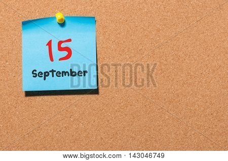 September 15th. Day 15 of month, color sticker calendar on notice board. Autumn time. Empty space for text.