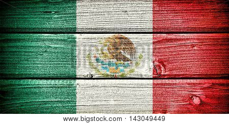 flag of Mexico painted on old grungy wooden background:3d illustration