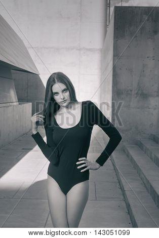 Beautiful model wearing one-piece body lingerie - modern fashion style