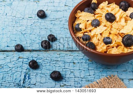Breakfast: A Plate Of Dry Cornflakes In A Clay Plate