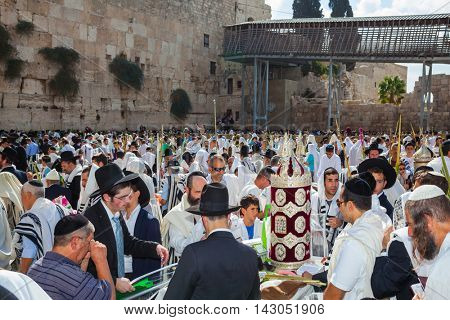 JERUSALEM, ISRAEL - OCTOBER 12, 2014: Sukkot. The Jews brought the Torah scroll for prayer. The area in front of Western Wall of Temple filled with people