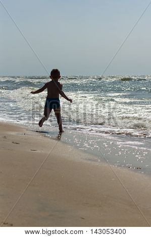 The Little Boy Frolics At The Sea