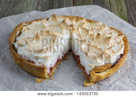 Sliced Meringue Cake With Strawberry Jam On Baking Paper